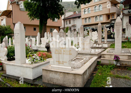 War cemeteries inside city at Mostar; they contain the graves of people who died during the Civil War of 1995 - Stock Photo