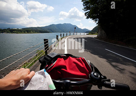 Biking in the Kawaguchi Lake area in southern Yamanashi Prefecture near Mount Fuji, Japan. - Stock Photo