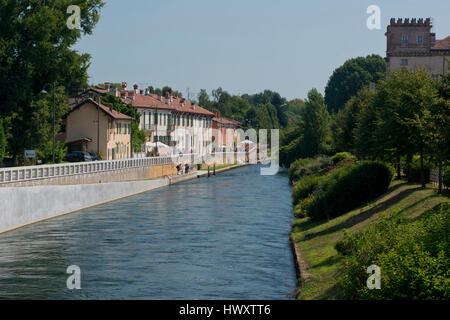 Palaces on the riverside of Naviglio Grande, near Robecco sul Naviglio, Italy - Stock Photo