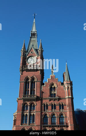 The clock tower of the St. Pancras Renaissance London Hotel, originally the Midland Grand Hotel designed by George - Stock Photo