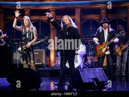 The rock group, 'Lynryd Skynyrd', with Johnny Van Zant on lead vocals, center, Rickey Medlocke on guitar, left, - Stock Photo