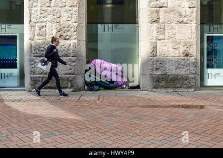 Homeless person sleeping rough in Birmingham city centre,UK. - Stock Photo