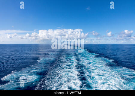 Wake of ship at sea in Atlantic Ocean with blue sky - Stock Photo