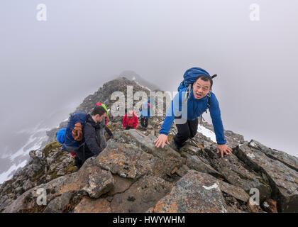 UK, Scotland, Glencoe, mountaineers at Stob Coire Nan Lochan - Stock Photo