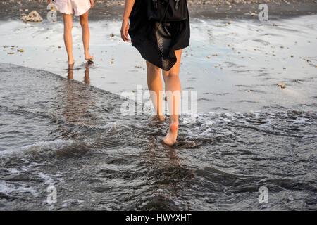 Indonesia, Bali, two women wading in the sea - Stock Photo