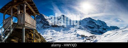 Switzerland, Canton of Bern, Grindelwald, Kleine Scheidegg, summit station and Eiger North Face - Stock Photo