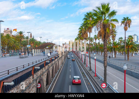 Late afternoon in Seaside Barcelona, Spain, sees traffic in tunnelled streets & pedestrian traffic above as people - Stock Photo