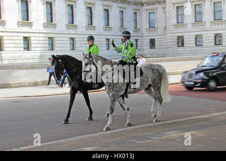 Mounted Police passing Horseguards Parade in London, England, UK - Stock Photo