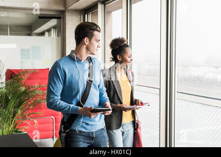 Young business people walking together in office - Stock Photo