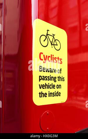 Warning Cyclist sign on Bus,Birmingham,UK. - Stock Photo