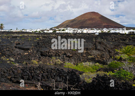 view on the typical Landscape and the La Woerden Volcano near Tahiche, Lanzarote, Spain - Stock Photo