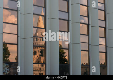 One tower of the Fisherman's Bastion reflecting in the glass window of an hotel. - Stock Photo