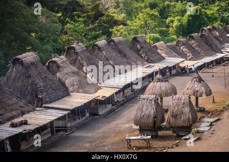 Traditional huts in the Indonesian village Bena on Flores island, Indonesia - Stock Photo