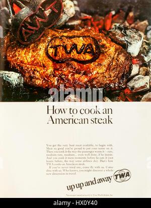 1960s magazine advertisement advertising the American airline TWA. - Stock Photo