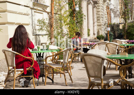 Woman tourist at the ag Haz cafe in Budapest Hungary - Stock Photo