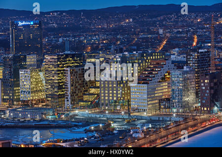 The Bjorvika neighborhood by night in Oslo, Norway. The area is an inlet in the inner Oslofjord and is considered - Stock Photo