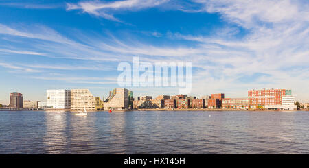 Netherlands, Amsterdam, view to Westerdok, IJDock with IJ River in the foreground - Stock Photo