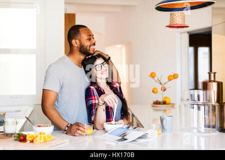 Young couple having breakfast in the kitchen - Stock Photo