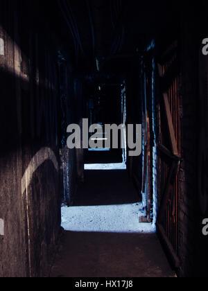 dark creepy basement. Portugal  Long dark creepy hallway in abandoned industrial basement Stock Photo