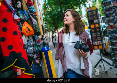 Young woman in Sevilla looking at shops - Stock Photo