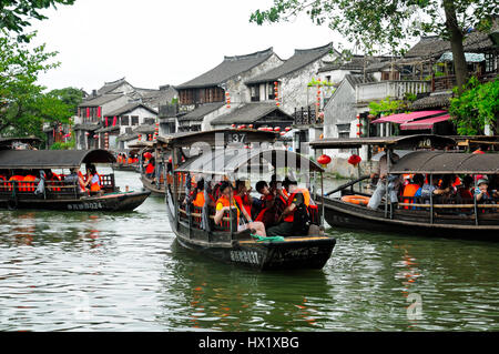 August 8, 2015.  Xitang Water Town, China.  Crowded tourist boats on the water canals of Xitang Town in Zhejiang - Stock Photo