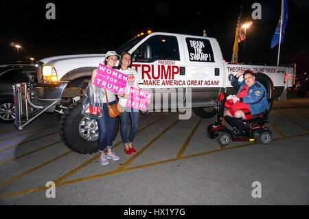 Attendees outside taking photos against a supporters truck a President Donald J Trump Rally at Louisville Exposition - Stock Photo