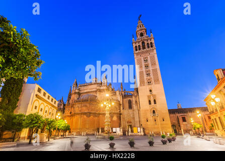 Seville, Spain. Cathedral of Saint Mary of the See with the Giralda bell tower. - Stock Photo