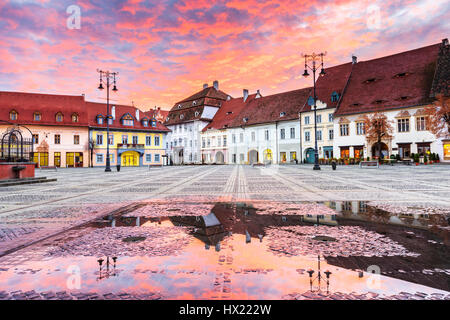 Sibiu, Romania. Large Square (Piata Mare) at sunrise. Transylvanian medieval city. - Stock Photo