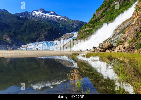 Juneau, Alaska. Mendenhall Glacier Viewpoint with reflection in the lake and waterfall. - Stock Photo