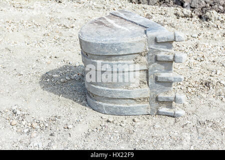Excavator's tool, bucket, blade on the ground, close up shoot - Stock Photo