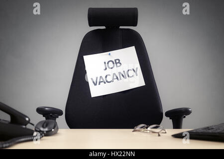 Office chair with job employee vacancy sign business concept for vacant position, employment, interview and careers - Stock Photo
