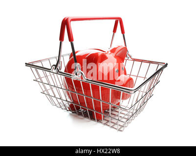 Piggy bank in shopping basket on white background concept for cost of grocery shopping - Stock Photo