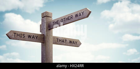 Crossroad signpost saying this way, that way, the other way concept for lost, confusion or decisions - Stock Photo