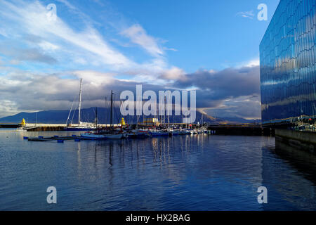 Port of Reykjavik. The sky is reflected in the water. Yachts in the port of Reykjavik - Stock Photo