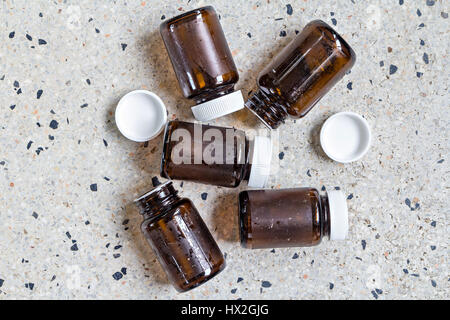 Used glass bottles for recycle on terrazzo floor - Stock Photo