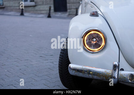 Istanbul, Turkey - March 4, 2017: White VW Beetle with interesting new style headlight in a street - Stock Photo