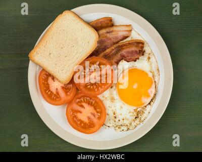 Authentic Flat Lay Colourful English Breakfast, Fried Bacon Egg, Sunny Side Up, and Grilled Tomatoes - Stock Photo