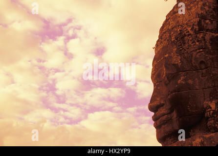 Buddha statue in profile at the Bayon temple. Siem Reap, Cambodia - Stock Photo
