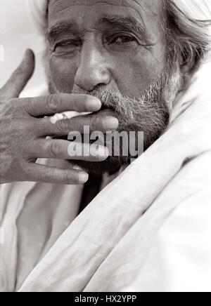Senior rural Indian man smoking Bidi. Jaisalmer, India - Stock Photo