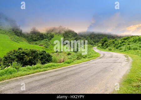 Mountain road view in the north of Laos wide and cloudy low lighting after raining - Stock Photo