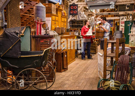 Young adult couple shopping at Aurora Mills Architectural Salvage in Aurora, Oregon. - Stock Photo