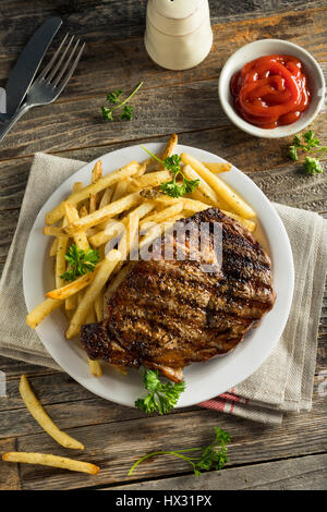 Hearty Homemade Steak and French Fries Ready to Eat - Stock Photo