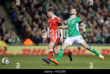Wales' Ben Davies and Republic of Ireland's Shane Long battle for the ball during the 2018 FIFA World Cup Qualifying, - Stock Photo