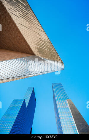 The roof of the Rotterdam Centraal railway station and Gebouw Delftse Poort (twin-tower skyscraper complex), Rotterdam, - Stock Photo