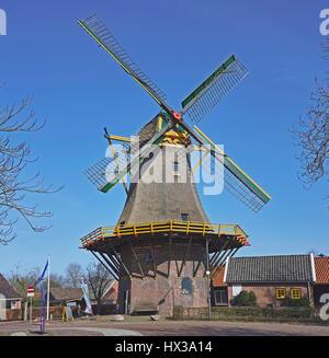 Grain mill 'De Hoop' or 'Molen van Buursink' in Markelo, the Netherlands, with green, red and yellow painted wooden - Stock Photo