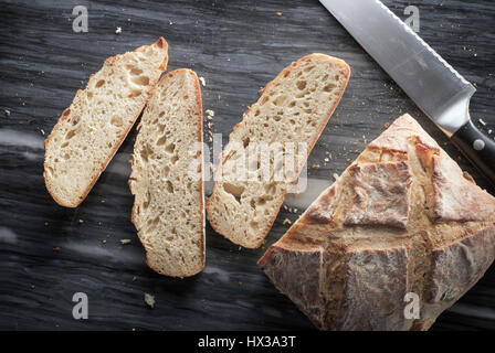 Partially-sliced artisan bread - from above - Stock Photo