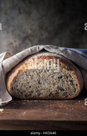 Freshly baked Wholegrain loaf of bread - Stock Photo