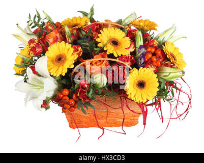 Flower arrangement in orange basket, roses, yellow gerbera daisies and white lilies, isolated on white background. - Stock Photo