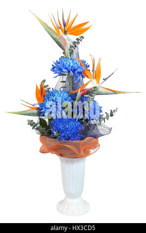 Florist designed bouquet in plastic vase, deep blue autumn chrysanthemum, and heliconia, isolated on white background. - Stock Photo