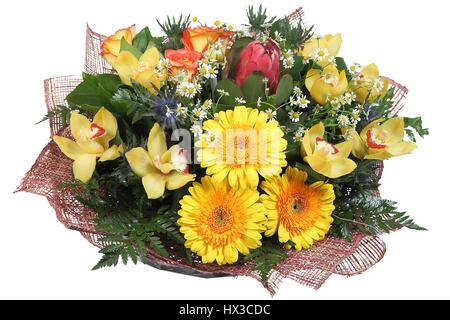 Flower Arrangement large mixed floral bouquet of yellow gerberas, pale yellow orchids, artichokes, orange roses, - Stock Photo